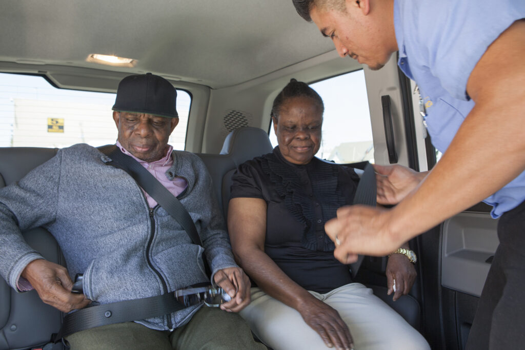 driver buckling in african american couple