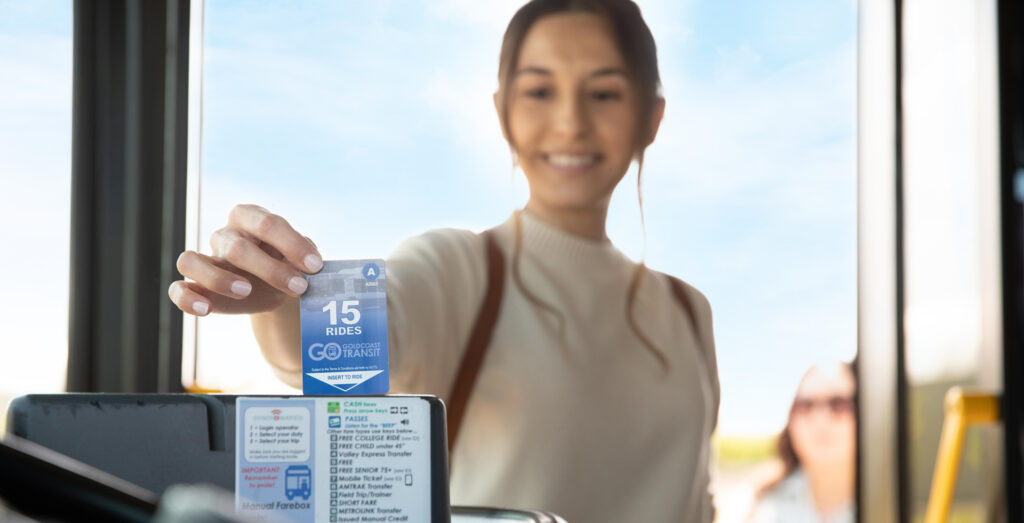 woman inserting her 15-ride pass into the farebox