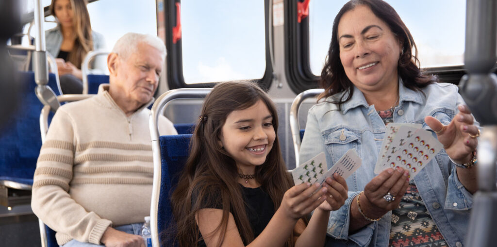 grandmother riding the bus with her grand-daughter